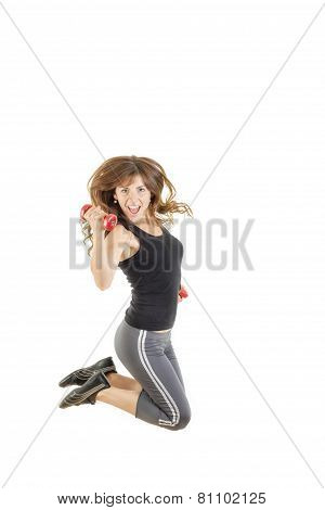 Female Model In Jump Flexing And Showing Muscles With Weights