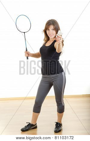 Young Woman Holding Racket And Shuttlecock Playing Badminton