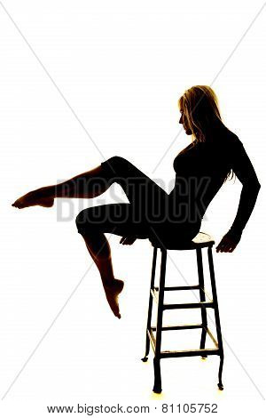 Silhouette Of A Woman Leg Out On A Chair