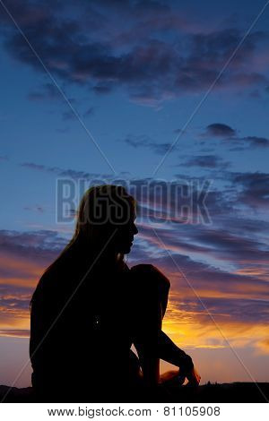 Silhouette Of A Woman Sitting Tired