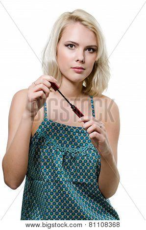 young girl doing makeup