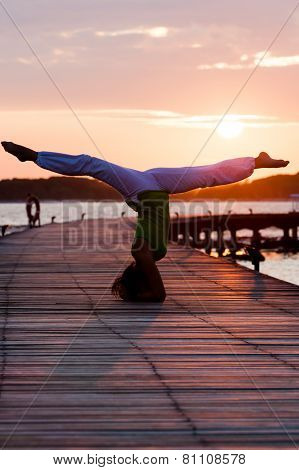 Practicing yoga asanas during the sunset