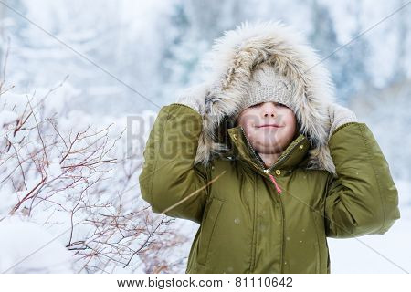 Adorable little girl outdoors on beautiful winter snow day