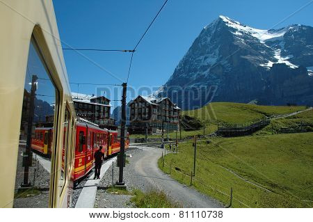 Eiger Mountain And Train In Kleine Scheidegg In Switzerland