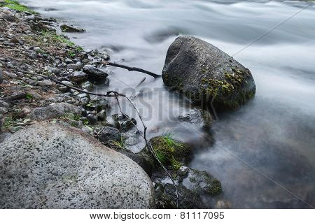 Stones among rapid water flow