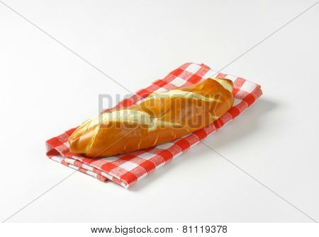 crunchy bread roll on the fabric linen with red squares