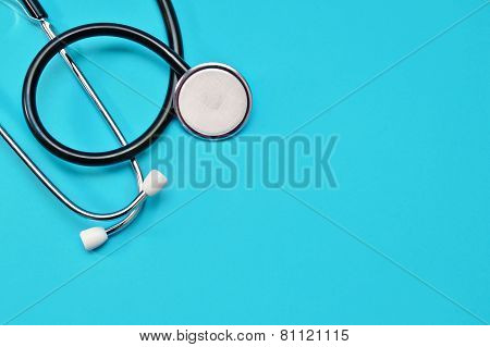 Medical Stethoscope on a blue background closeup