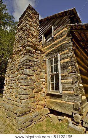 Two story log cabin chimney