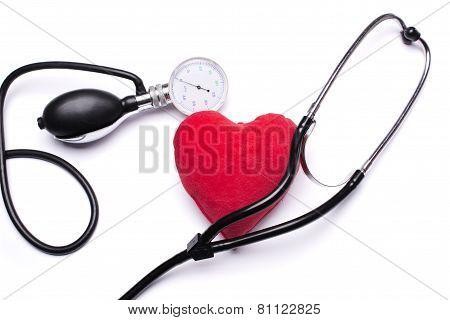 Stethoscope, red heart and hemopiezometer