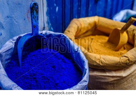 Bags of blue and yellow paint, Chefchaouen, Morocco