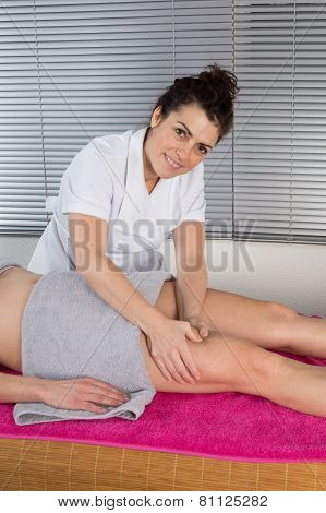 Woman Physio Therapist Trying To Fix The Leg Over