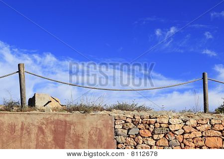 Traditional Rope Fence Over Stone Wall Grunge