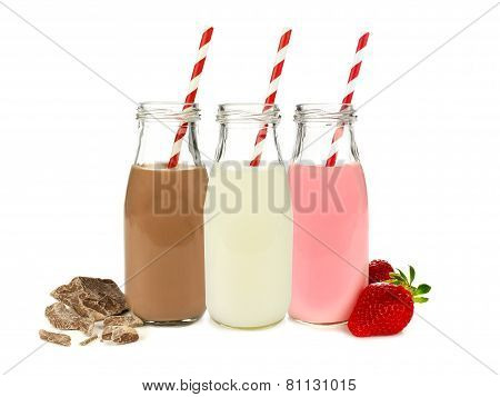 Various Flavors Of Milk In Bottles