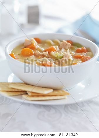 chicken noodle soup with crackers and copysapce composition