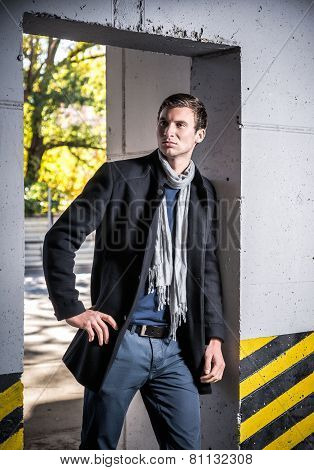 Fashion Shot: Handsome Young Man Wearing Coat And Jeans