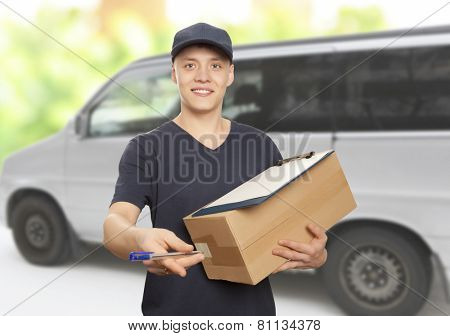 Handsome young delivery man portrait