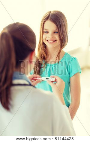 healthcare, child and medicine concept - female doctor with child measuring temperature in hospital