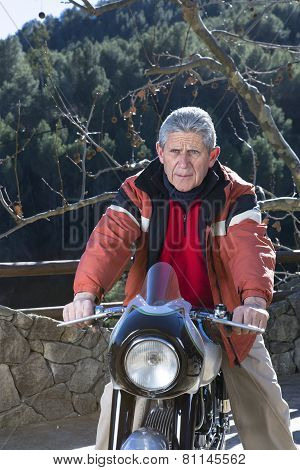 Man Riding A Motorbike.