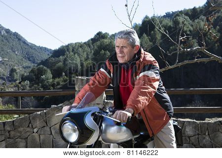 Man Sitting On A Motorbike.