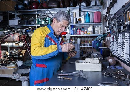 Mechanic At The Workshop.