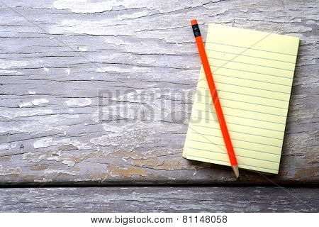 Notepad and a colorful pencil