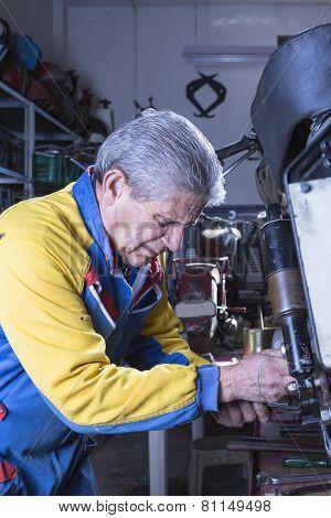 Mechanic Repairing A Motorbike Footrest