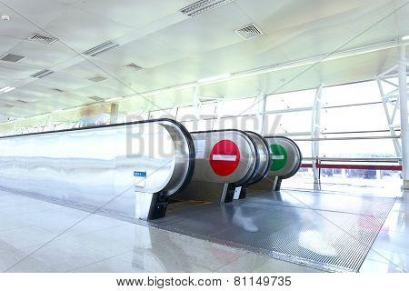 airport corridor and escalator,