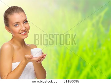 Young healthy girl with body cream jar isolated