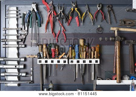 Tools On A Metal Board .