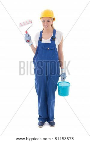 Young Woman In Blue Builder Uniform With Paint Brush And Bucket Isolated On White