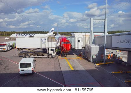 HELSINKI, FINLAND - SEP 03: docked Norwegian aircraft on September 03, 2014. Norwegian is the second largest airline in Scandinavia and the third largest low-cost airline in Europe