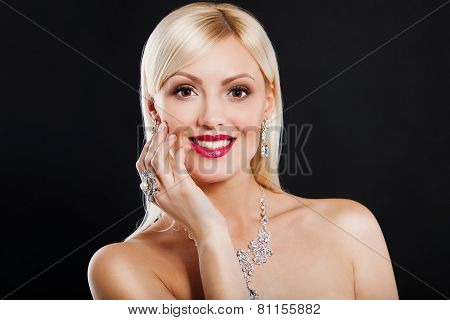 portrait of a beautiful blonde girl with luxury accessories. luxurious necklace