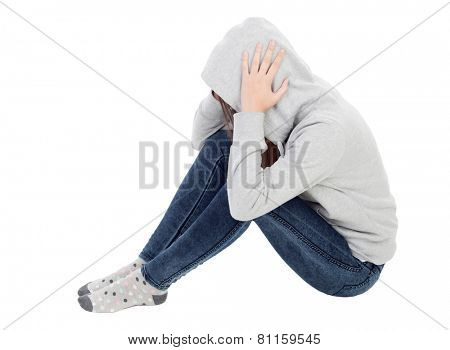 Sad teenager girl with gray sweatshirt hooded isolated on white background
