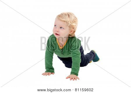 Adorable blond baby crawling isolated on a white background