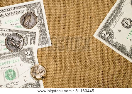 Ancient Coins And Dollar Notes On Sacking
