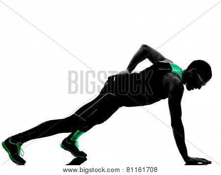 one man exercising push ups fitness  in silhouette isolated on white background
