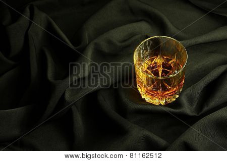Whiskey On Black Cloth