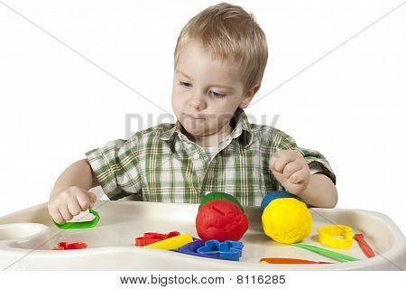Happy Child Playing With Plasticine
