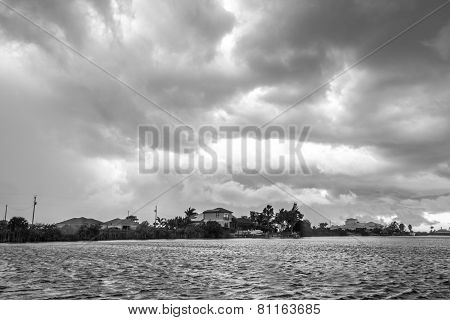 Dark clouds hovering over the water
