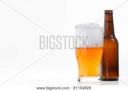 Beer bottle and glass with cold beer