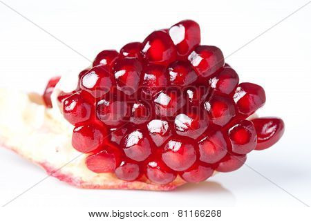 Pomegranate Seeds Closeup. Part Of Pomegranate Fruit. White Background. Macro View. (soft Focus).