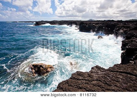 Dynamic Coastline With Volcanic Rock Cliffs
