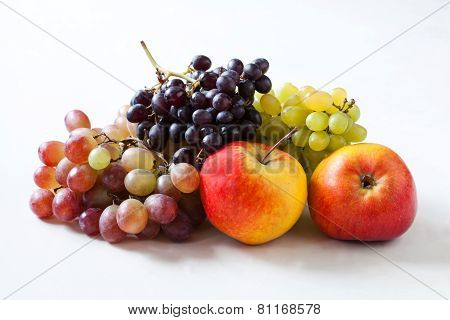 pples and grapes on a white background
