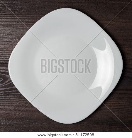 square plate on the wooden brown table