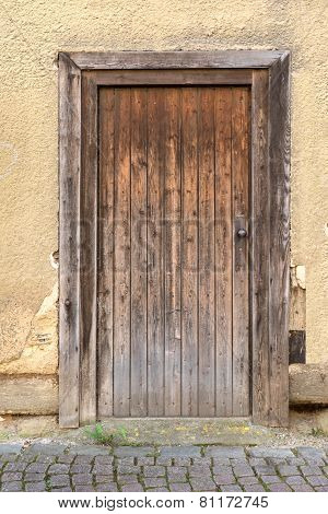 Weathered brown wooden door