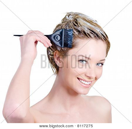 Cheerful Woman With Brush Coloring Hair