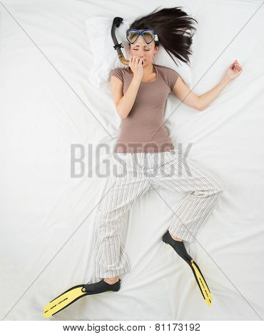 Woman sleeping with flippers and diving mask