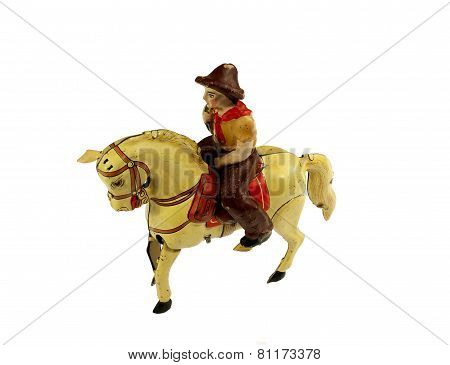 Vintage horse with cowboy wind-up tin toy