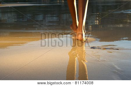 Low Angle African American Woman Walking On Beach