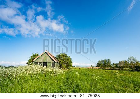 Abandoned Wooden Shed In A Colorful Spring Landscape